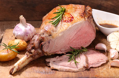 Slow roasted leg of lamb with braised fennel and onions